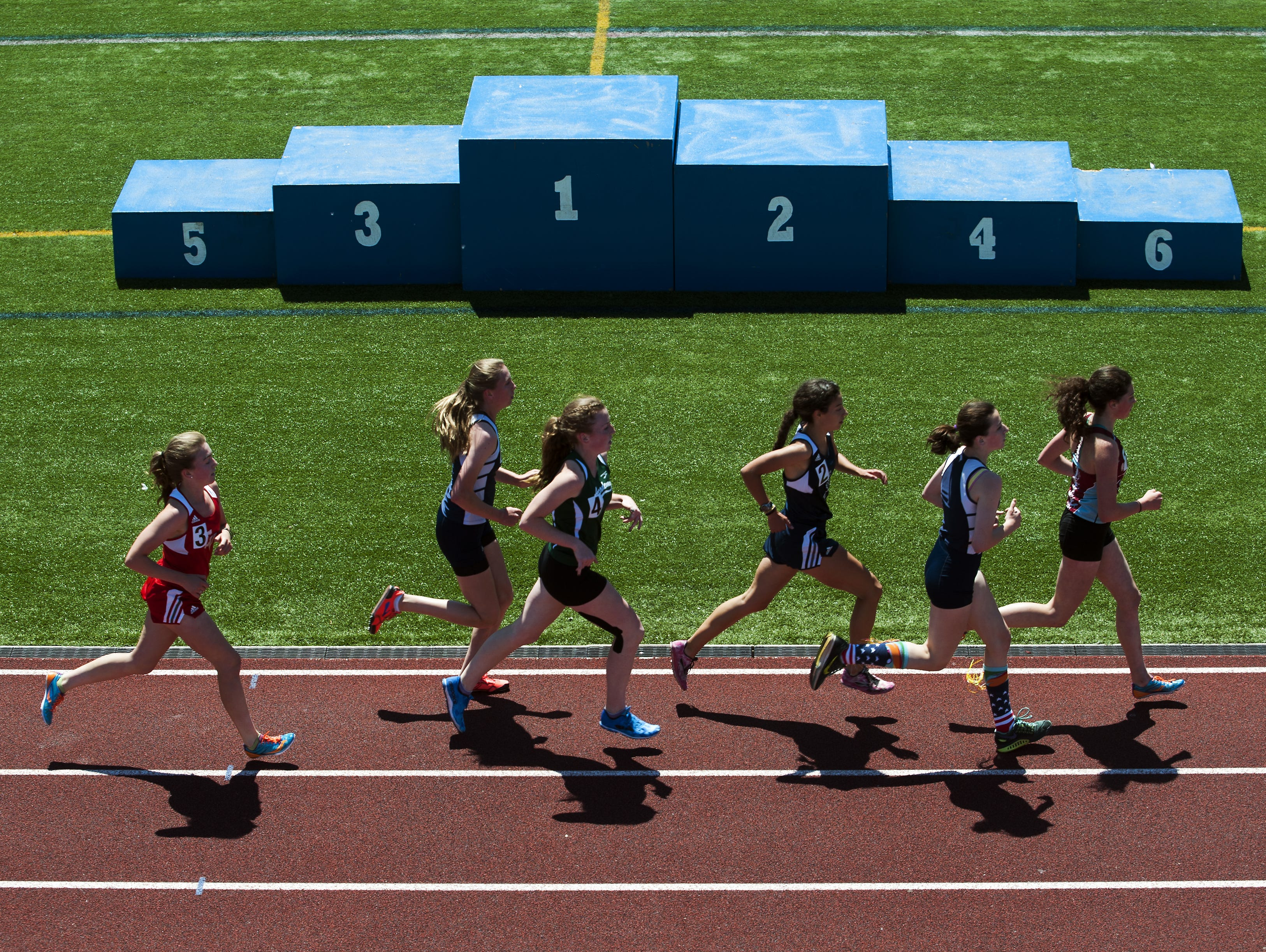 Racers compete in the 3000m run during the high school track and field state championship meet at Burlington High School on Saturday June 6, 2015 in Burlington, Vermont.