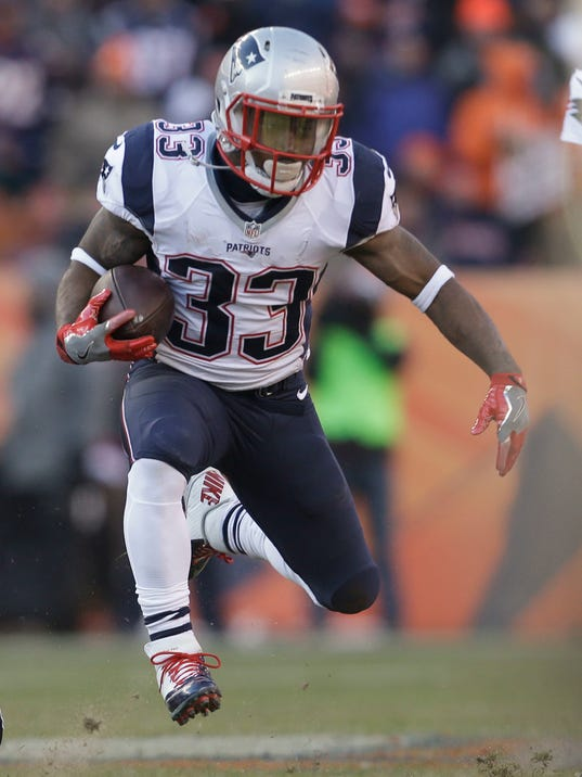 FILE - In this Dec. 18, 2016, file photo, New England Patriots running back Dion Lewis runs against the Denver Broncos during the first half of an NFL football game in Denver. The Pittsburgh Steelers and Patriots meet in the AFC championship game on Sunday, Jan. 22. (AP Photo/Joe Mahoney, File)