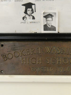 Photographs and a plaque on display in the alumni room at the Booker T. Washington Community Center, formerly Booker T. Washington High School.
