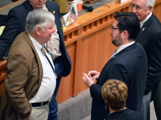 New Mexico Rep. Paul C. Bandy, left, an Aztec Republican, speaks with New Mexico House Speaker Brian Egolf, right, a Santa Fe Democrat, on the House floor on Thursday, Feb. 15, 2018, in Santa Fe, N.M at the New Mexico Statehouse. The New Mexico Legislature wrapped up a 30-day session Thursday after approving a $6.3 billion budget bill that shores up spending on the criminal justice system and public education with pay raises allotted to teachers and state workers. (AP Photo/ Russell Contreras)
