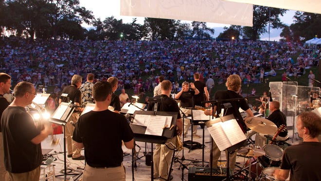 The Kentucky Symphony Orchestra performs at the Devou Park band shell in 2010, during a summer concert series.