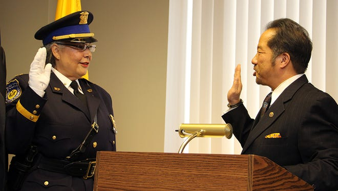 Anne FitzSimmons is sworn in as White Plains Police Chief by Public Safety Commissioner David Chong.