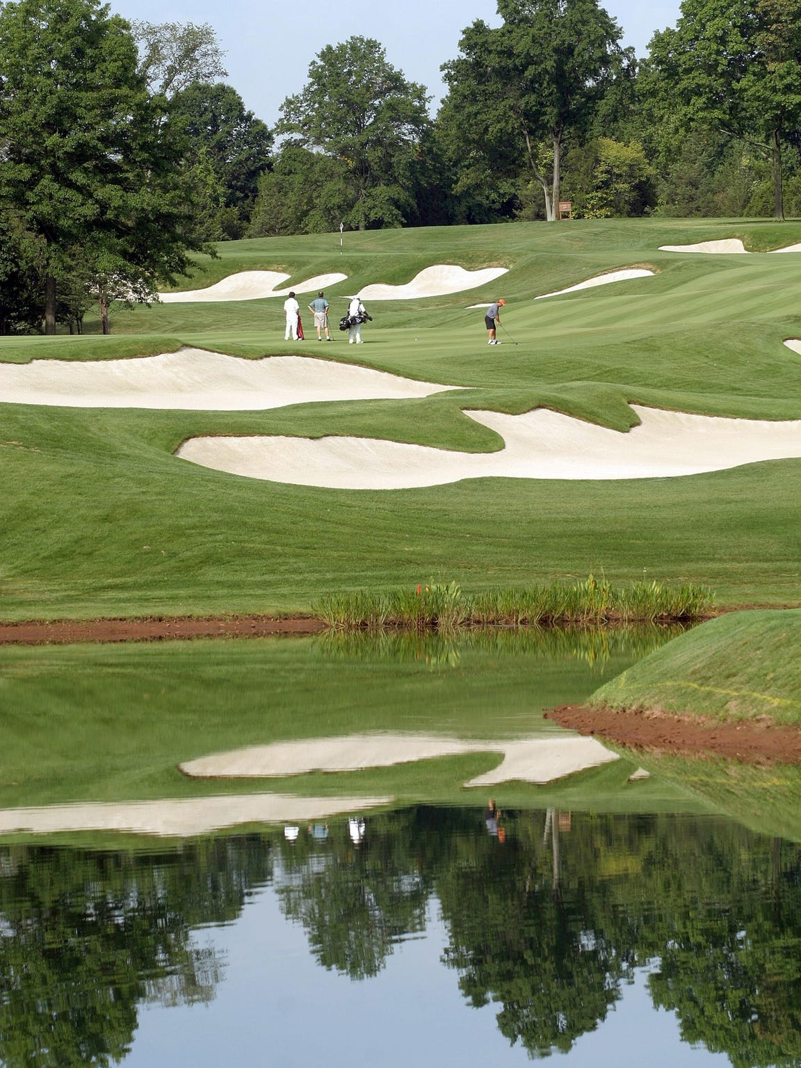 Golfers hit from one of the fairways at Trump National