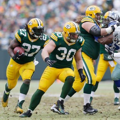 Green Bay Packers fullback John Kuhn (30) blocks for