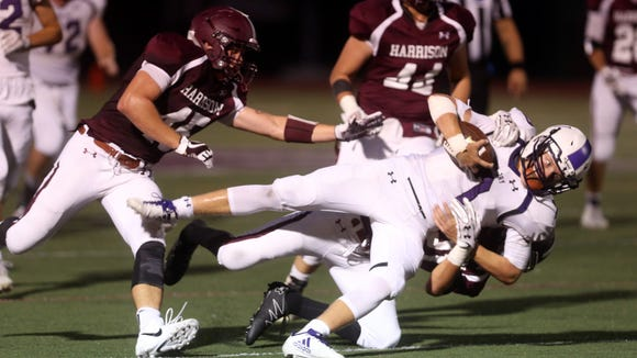 John Jay quarterback Bryce Ford is brought down by