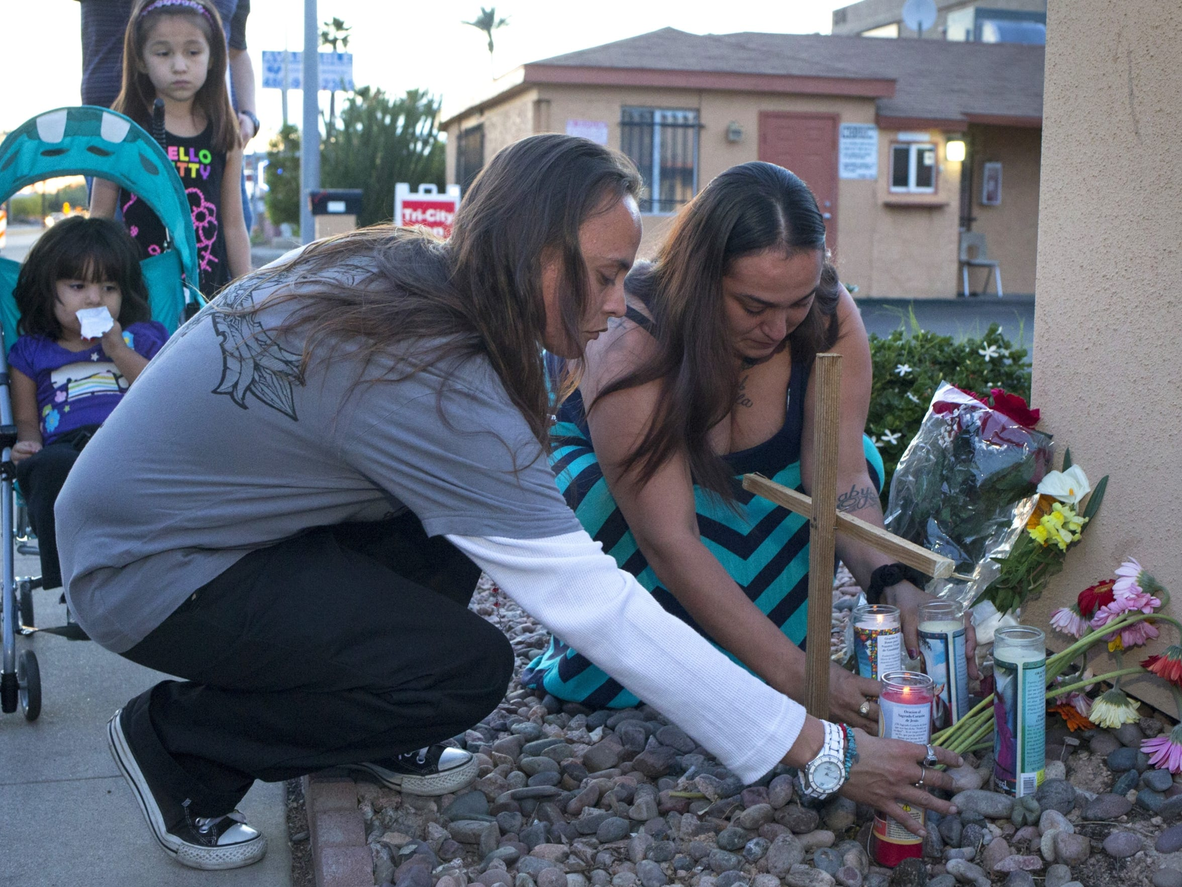 Veronica Ehrig (center) places a candle, March 19,