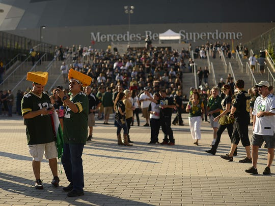 Green Bay Packers fans gather outside the Superdome