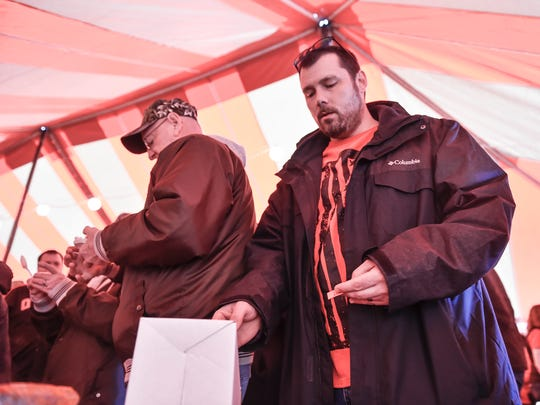 Jamie Hampton cast his vote for Webb's Bar and Grill Chilli as his favorite during the Chili Cook-Off at IceFest on Saturday, Jan. 30, 2015 in Chambersburg, Pa.