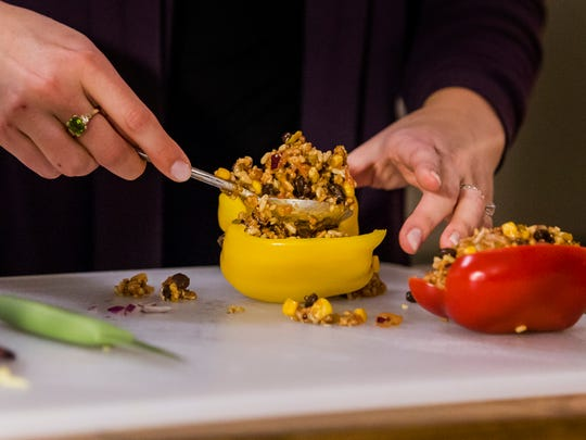 Emily Postel prepares a meal of Mexican stuffed peppers, with lean ground turkey, rice and beans.