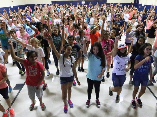 More than 200 sixth- and seventh-graders perform their school spirit dance at the new Young Women's Leadership Academy summer camp Wednesday at 7615 Yuma Drive.