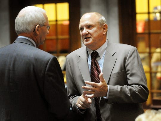 Luke Kenley, right, a retired state senator from Noblesville, spent 15 years pushing for online retailers to charge sales taxes on purchases.