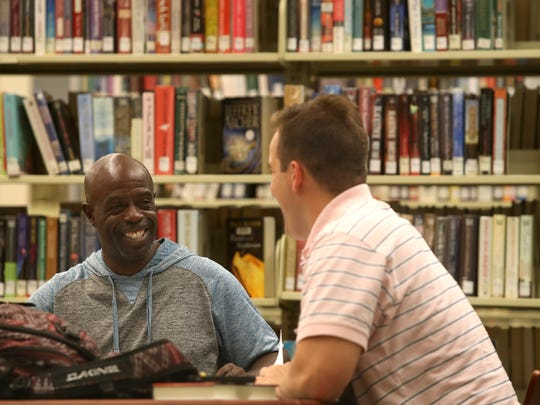 Alonzo Scott, left, works with volunteer tutor Luke Roi on Scott's upcoming test to earn his GED.