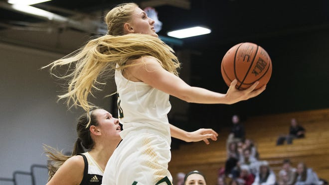 Catamounts forward Hanna Crymble (10) leaps for a layup during the women's basketball game between the Bryant Bulldogs and the Vermont Catamounts at Patrick Gym on Friday night.