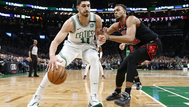Celtics center Enes Kanter tries to get around Bulls center Daniel Gafford during a game on Jan. 13 at TD Garden. Kanter has always been politically active, both here and in his native Turkey.
