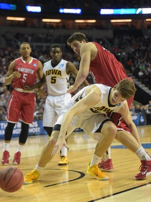 Iowa Hawkeyes center Adam Woodbury (34) plays for the