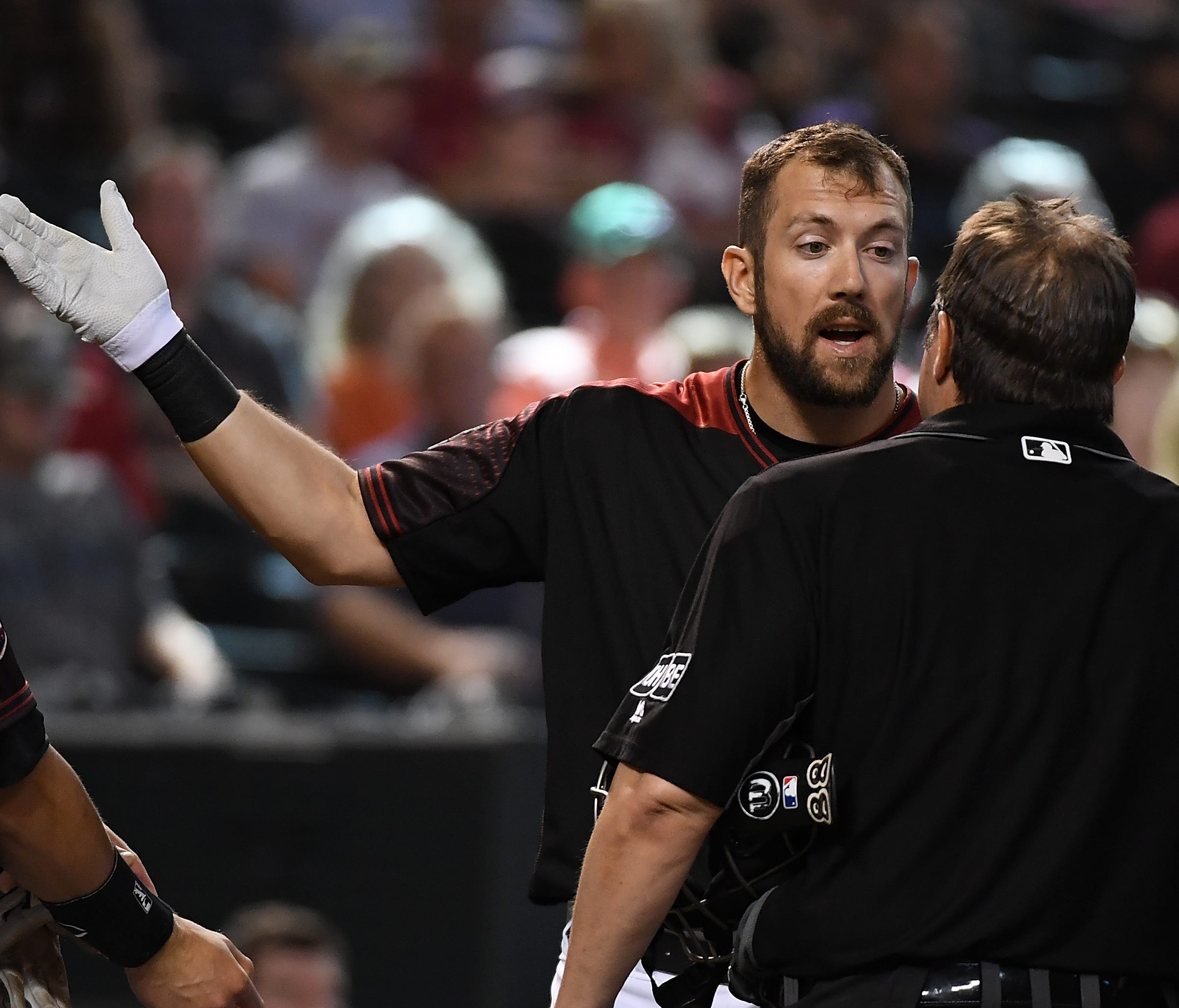 While player-umpire tensions can boil over - such as this ejection of Steven Souza Jr. by Doug Eddings - most players prefer retaining the human element.