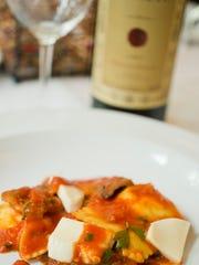 Ricotta ravioli, crispy eggplant, tomato, fresh mozzarella, at L'Amante.
