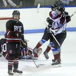Rye Town/Harrison's Sam Adler, right, scored the first goal of the game as Rye and Rye Town/Harrison battled in a Division II playoff game at the Playland Ice Casino Feb. 23, 2015.