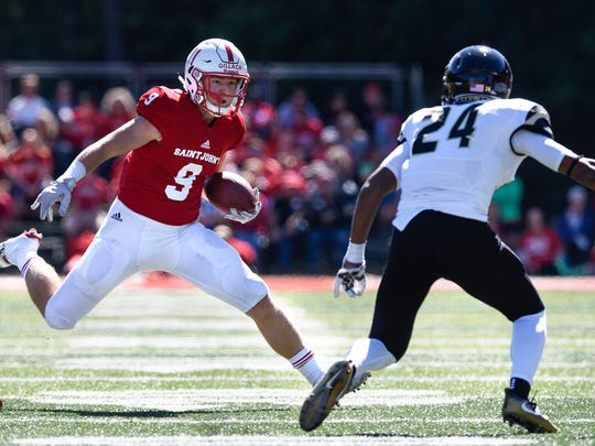 Will Gillach carries the ball for St. John's during the Saturday, Sept. 17 game against St. Olaf at Clemens Stadium in Collegeville.