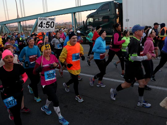 Runners cross over the Ambassador Bridge on the American side at the third mile mark during the 37th Annual Detroit Free Press/Talmer Bank Marathon in Detroit on Sunday, Oct. 19, 2014.
