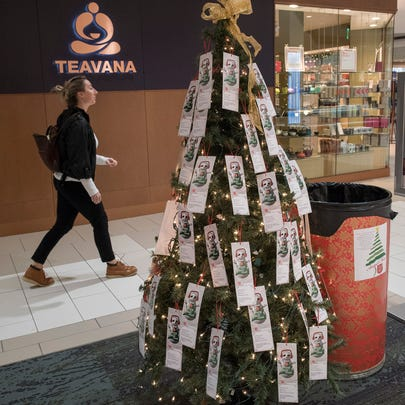 A Salvation Army giving tree stands in Laurel Park