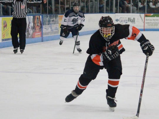 Nick Kirch of Middletown North races after a puck.