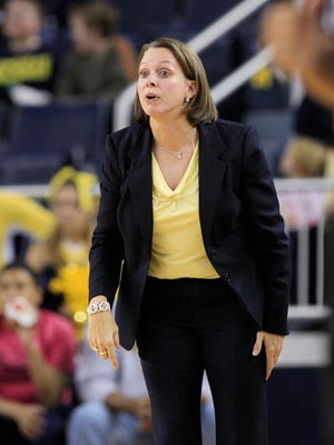 Dawn Plitzuweit, shown as an assistant coach with Michigan in 2012, was named USD's new head coach Friday. She will be introduced during a news conference Monday.