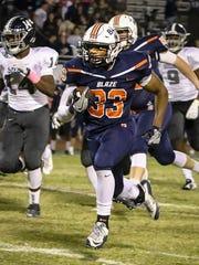 Blackman junior running back Master Teague finds running