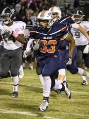 Blackman junior running back Master Teague finds running room during a 2016 game. Teague named his top 12 college choices on Sunday.