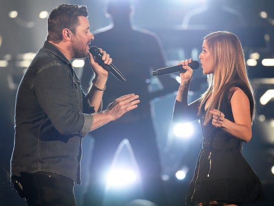 "Chris Young and Cassadee Pope sing ""Think of You"" during"