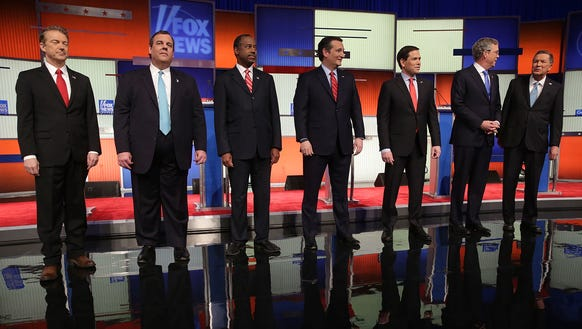GOP candidates line up on stage before the Jan. 28