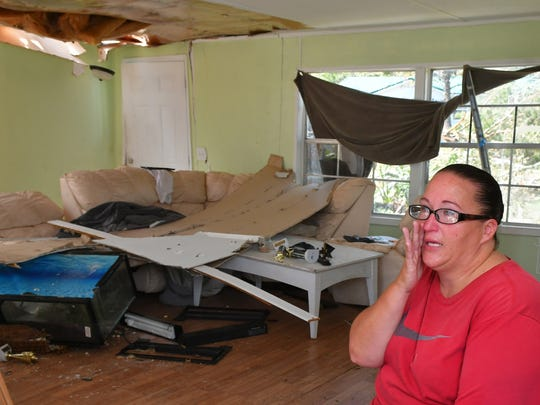 Sitting near what was once the living room. Lisa Justice, seen here, her husband David, and their five children had their manufactured home in Mims destroyed from a tornado spawned by Hurricane Irma. Several other homes were damaged by this same tornado.