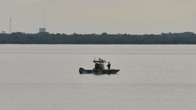 Brevard County authorities search the Indian River just south of State Road 405 for a missing twin-engine Cessna aircraft that disappeared on Wednesday, Aug. 26, 2015.