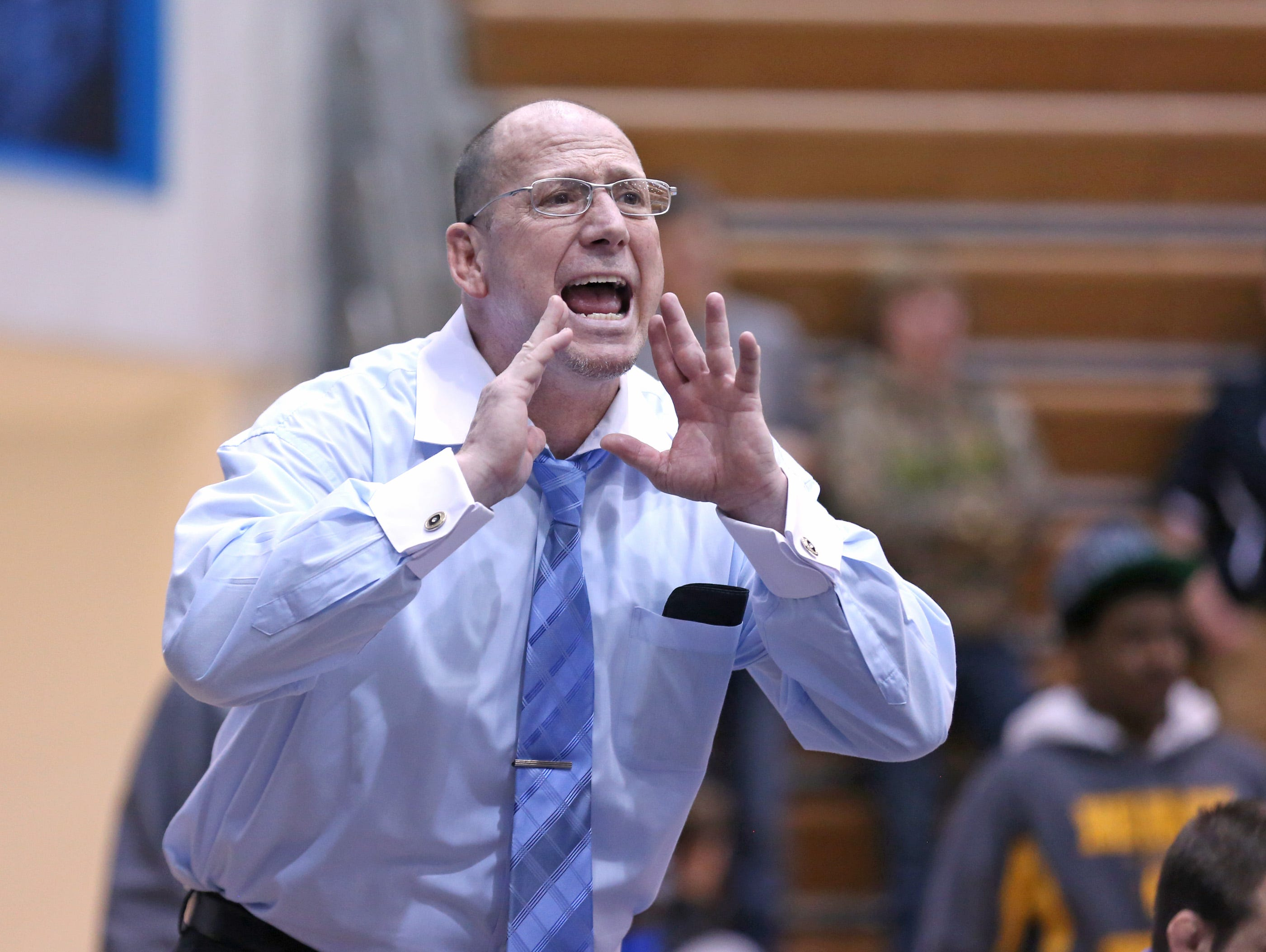 Perry Meridian head coach Jim Tonte calls out to a competitor during the wrestling regional finals at Perry Meridian High School Saturday February 8, 2014.