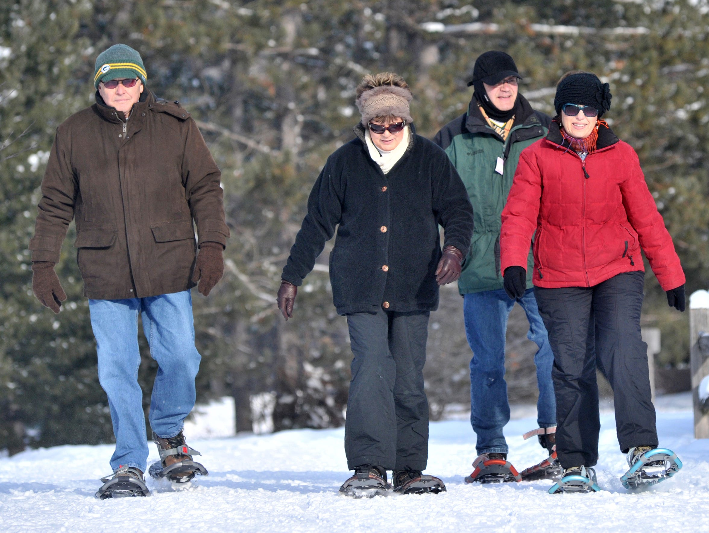 In this file photo, a group of people snowshoe on Dec.