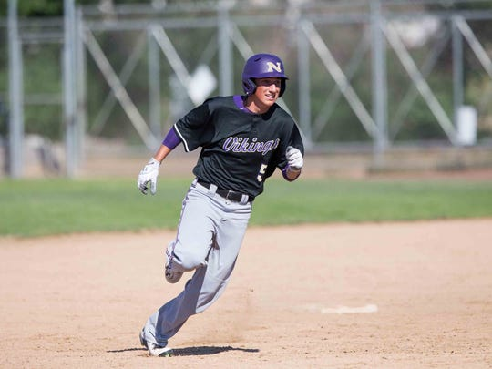 Bryce Wlodarchak of North Kitsap rounds second base during the Vikings' 6-3 loss to Ellensburg in a Class 2A semifinal game in Yakima.
