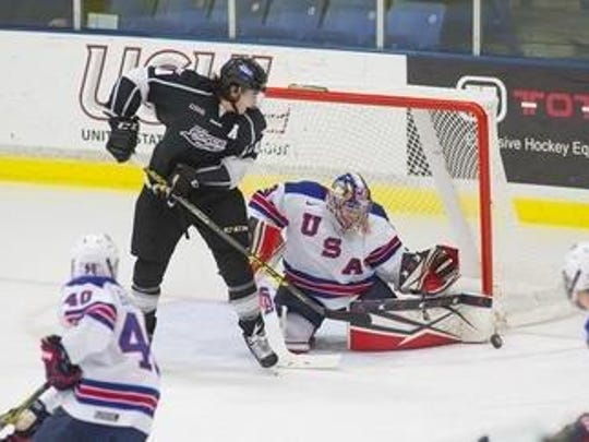 Goalie Dylan St. Cyr, a Northville resident, makes a stop for the U.S. NTDP Under-17 team in 2015-16. The University of Michigan commit is now with the U18 team.