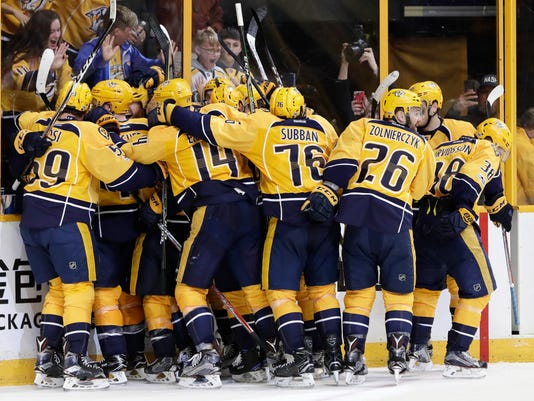 Nashville Predators players celebrate after beating the Chicago Blackhawks in overtime in Game 3 of a first-round NHL hockey playoff series Tuesday, April 18, 2017, in Nashville, Tenn. The Predators won 3-2 to take a 3-0 lead in the series. (AP Photo/Mark Humphrey)