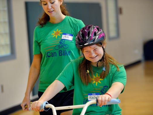 Rachel Lewis, 20, participates in iCan Bike, a program of iCan Shine, inside the gym of Taylors First Baptist Church's Family Life Center in Taylors on Tuesday, August 12, 2014. iCan Bike helps those with special needs ride a bike in one week.