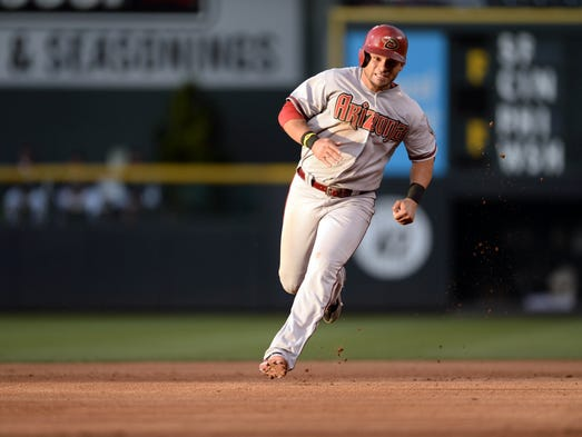June 5, 201: Diamondbacks right fielder Gerardo Parra (8) runs to third base in the fourth inning against the Colorado Rockies at Coors Field.