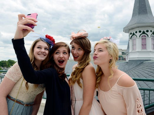 Patrons from left Laura Bubalo, Alyssa Cornish, Jenna Violet Semenova and Hope Carstanjen pose for a selfie photo from the trophy room balcony.