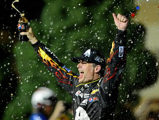 May 10, 2014; Kansas City, KS, USA; NASCAR Sprint Cup Series motorist Jeff Gordon celebrates in feat line after wining a 5-Hour Energy 400 during Kansas Speedway. Mandatory Credit: Andrew Weber-USA TODAY Sports