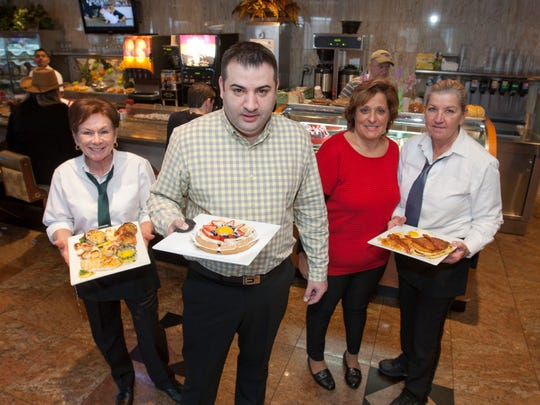 Owner and general manager Nick Zavolas with employees who have worked at the diner for over 20 years: Cornelia Putnam (left to right), Tasia Alexoboulos and Sherry Smith.