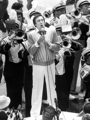 """Jim Nabors sings """"(Back Home Again in) Indiana"""" with the Purdue Marching Band during the opening ceremonies of the 1984 Indianapolis 500."""