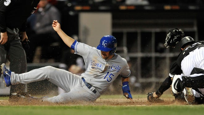 Kansas City Royals' Whit Merrifield (15) slides safely into home plate on a Mike Moustakas double while Chicago White Sox catcher Geovany Soto right, attempts to apply the tag during the third inning of a baseball game Monday, April 24, 2017, in Chicago. (AP Photo/Paul Beaty)