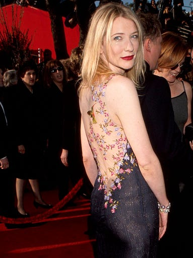 Cate Blanchett may be best known for making an indelible impression on screen, but in 1999 she truly arrived as a red-carpet siren. The actress made waves in this punk John Galliano gown at the Academy Awards. It which featured a sheer back dusted with tattoo-like flowers and hummingbirds.