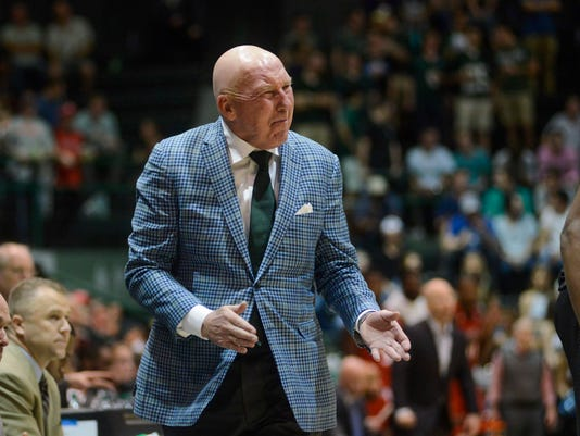 Tulane coach Mike Dunleavy yells to his players during the first half of an NCAA college basketball game against Cincinnati in New Orleans on Thursday, March 1, 2018. (AP Photo/Veronica Dominach)