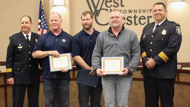 West Chester Assistant Police Chief Brian Rebholz is pictured with Silas Rose; his son, Tyler Rose; Richard Burke; and Chief Joel Herzog. Silas  Rose, Tyler Rose, and Burke received Civilian Commendation Awards for  their acts of heroism in assisting police.