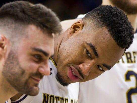 Notre Dame's Bonzie Colson, center, looks at teammate
