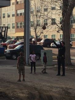 Sioux Falls Police Sgt. Andrew Siebenborn plays basketball with kids in the Pettigrew Heights neighborhood Sunday, March 19.